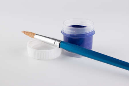 jars of colored paint for creativity on a white background