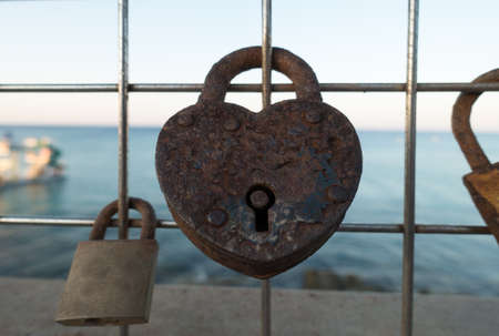 door locks as a symbol of long love leave tourists on the fence Stock Photo
