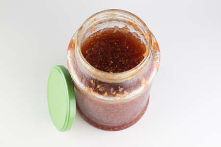 glass jar with raspberry jam isolated on a white background Stock Photo