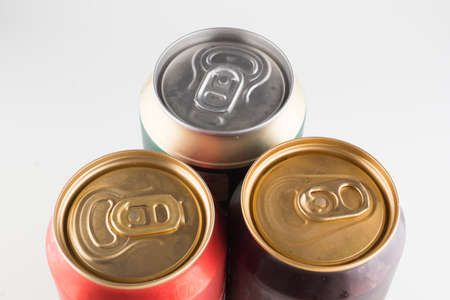 three metal cold cans with beer on a white background