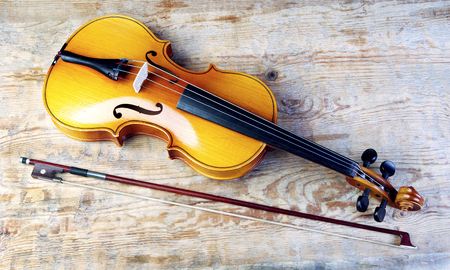 Violin on a wooden background.