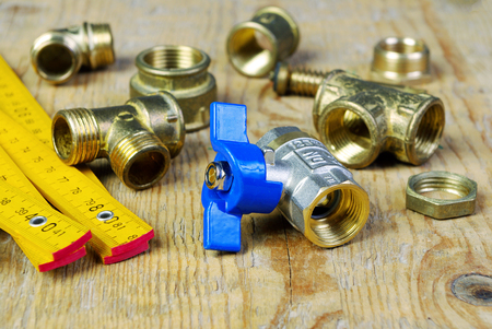 Water tap and fittings for water supply. Plumbing fixtures and piping parts. Sanitary and technical works.