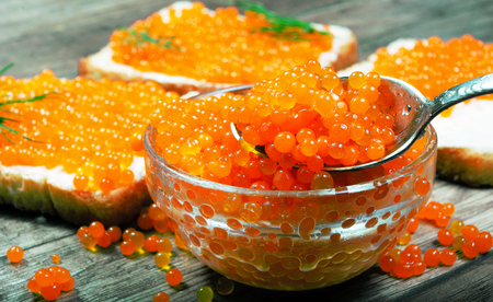 Red caviar. Red caviar and toast with red caviar. Close-up.