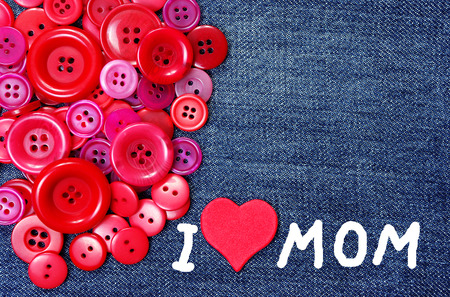 I love mom. Mothers Day. Red buttons texture background. Copy spaces. 스톡 콘텐츠