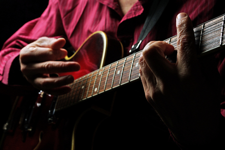 Guitarist hands and guitar close up. playing electric guitar. play the guitar. Stock Photo
