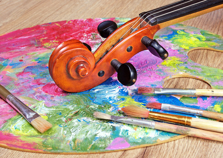 Violin, brushes and palette. close up