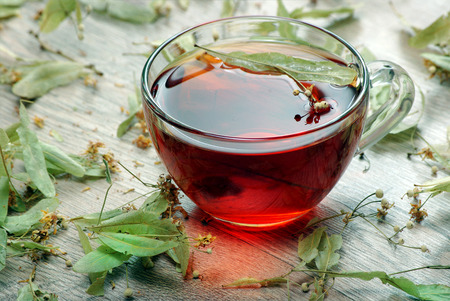 herbal tea. cup of tea on a wooden table. traditional remedy for cold and flu.