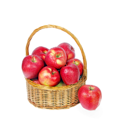 Red apples in wicker basket isolate on white. copy spaces