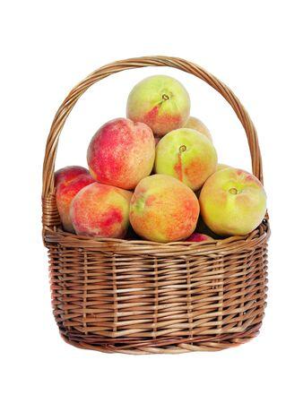 fresh ripe peaches in wicker basket isolated on white 版權商用圖片