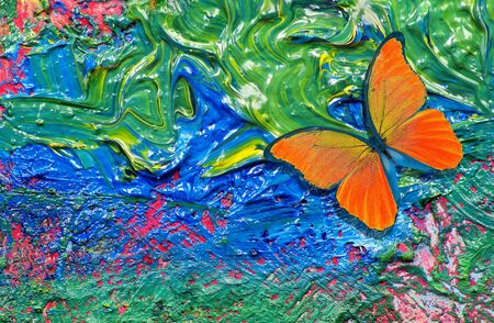colorful abstract background. orange butterfly. brush strokes on the palette close up. painted abstract background Stockfoto
