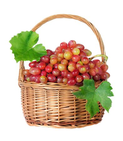 grapes in a wicker basket isolated on a white. copy spaces