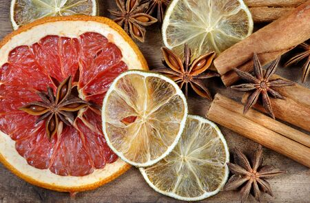 Christmas background of dried fruits and spices. dried grapefruit, orange, lime, anise stars and cinnamon sticks texture background