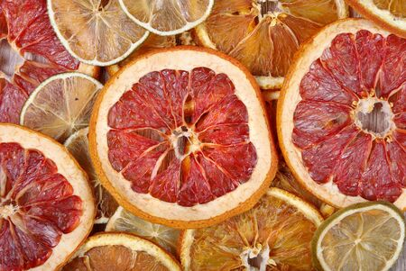 Christmas background of dried fruits. dried grapefruit, orange and lime texture background Reklamní fotografie