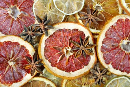 Christmas background of dried fruits and spices. dried grapefruit, lime and anise stars texture background Reklamní fotografie