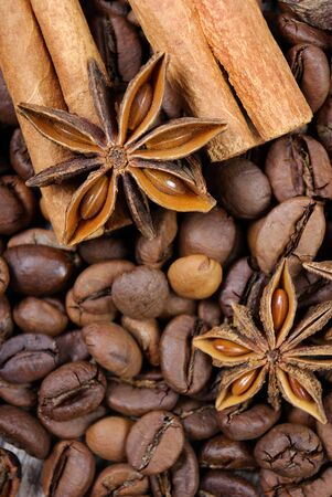 star anise, cinnamon, and roasted coffee beans. roasted coffee and spices.
