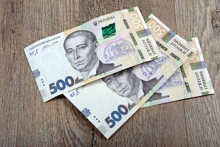 Ukrainian money. Banknote of Ukrainian hryvnias. Five hundred hryvnia banknotes on a wooden table.