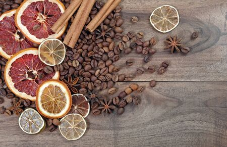 Christmas background. dried grapefruits, oranges and lime, stars anise, cinnamon, and roasted coffee beans. roasted coffee, dried fruits and spices texture background. top view. copy spaces