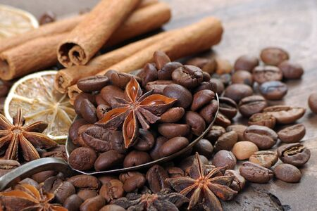 Christmas background. dried lime, stars anise, cinnamon, and roasted coffee beans. roasted coffee, dried fruits and spices texture Reklamní fotografie