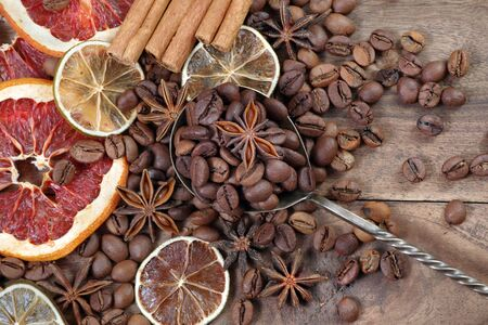 Christmas background. dried grapefruits, oranges and lime, stars anise, cinnamon, and roasted coffee beans. roasted coffee, dried fruits and spices texture background. top view Reklamní fotografie