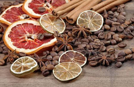 Christmas background. dried grapefruits, oranges and lime, stars anise, cinnamon, and roasted coffee beans. roasted coffee, dried fruits and spices texture background. Reklamní fotografie