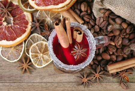 Christmas background. mulled wine, dried fruits and spices on a wooden table Reklamní fotografie