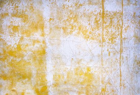 Background of old yellow wall. old yellow plastered wall. old shabby painted wall 版權商用圖片