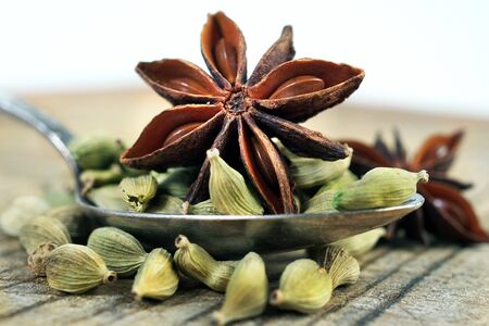 anise stars, cinnamon and cardamom on a wooden table. close up