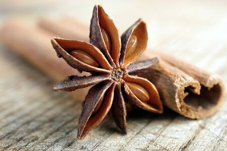 anise star and cinnamon on a wooden table close up.