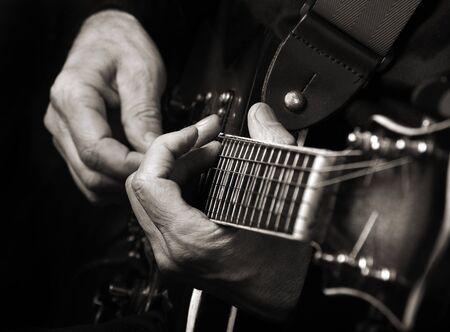 Guitarist hands and guitar close up. playing electric guitar. Standard-Bild