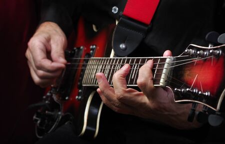 Guitarist hands and guitar close up. playing electric guitar.