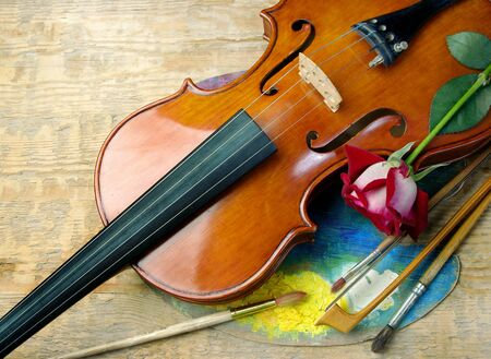 violin, brushes, rose and palette