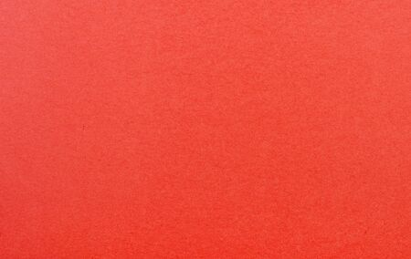 Plain red background. Red cardboard. Red paper texture background. Abstract geometric flat composition. Copy spaces