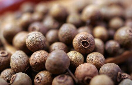 Jamaica pepper texture background. allspise close up. top view