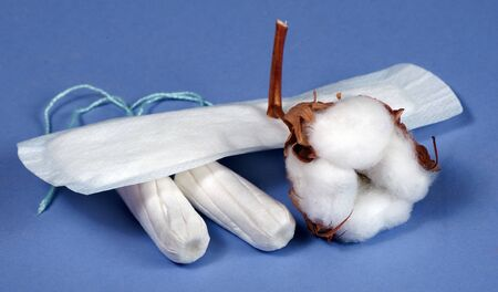 Cotton women's health care, cotton tampon, intimate hygiene, gynecological menstruation cycle.