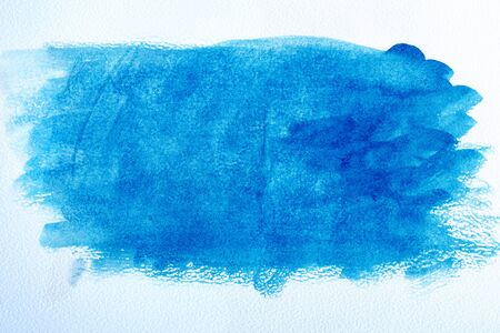 watercolor paper and blue watercolor paint. wet watercolor paper. abstract blue background. blue watercolor stains