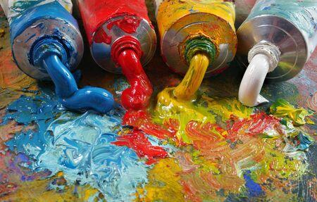 tubes with art oil paint on a palette. colorful art paints close-up