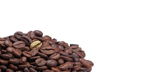 One of many. Gold coffee bean on a pile of coffee beans isolated on a white. The concept of luxury. copy space Foto de archivo