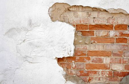 old cracked plastered brick wall texture background