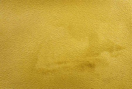 a sheet of watercolor paper painted with gold paint texture background Stock fotó