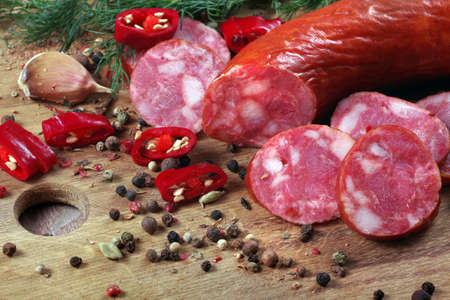 sausage on a board and spices close up Stock fotó
