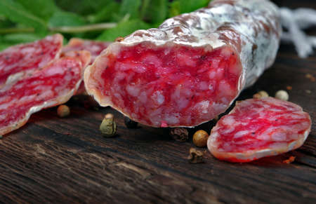 dried sausage on a wooden table. sausage fuet close-up