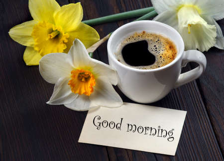 Good morning. Cup of coffee, daffodils and a note good morning on the table