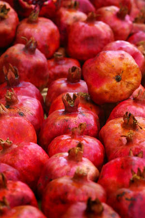 colorful ripe pomegranates in the market