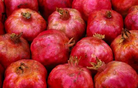 colorful ripe pomegranates in the market