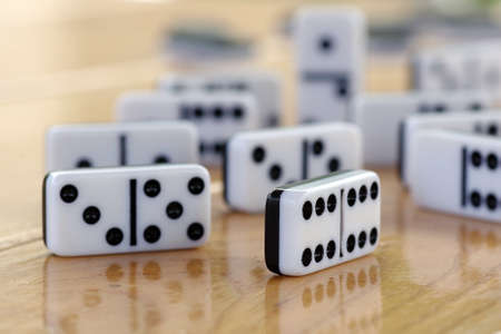 domino game on a wooden table. selective focus