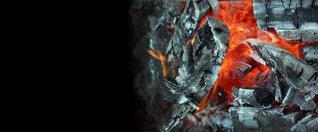 Coals and flames. Hot coals texture background