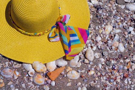 yellow beach hat on the sea sand. beach concept Фото со стока
