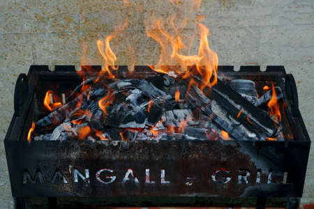 brazier with burning flames and coals