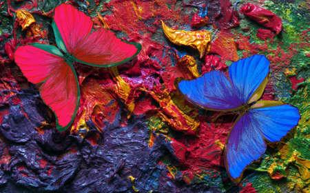 color concept. bright tropical morpho butterflies on an artist's palette.