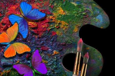 colors of rainbow. color concept. bright tropical morpho butterflies on an artist's palette. Standard-Bild